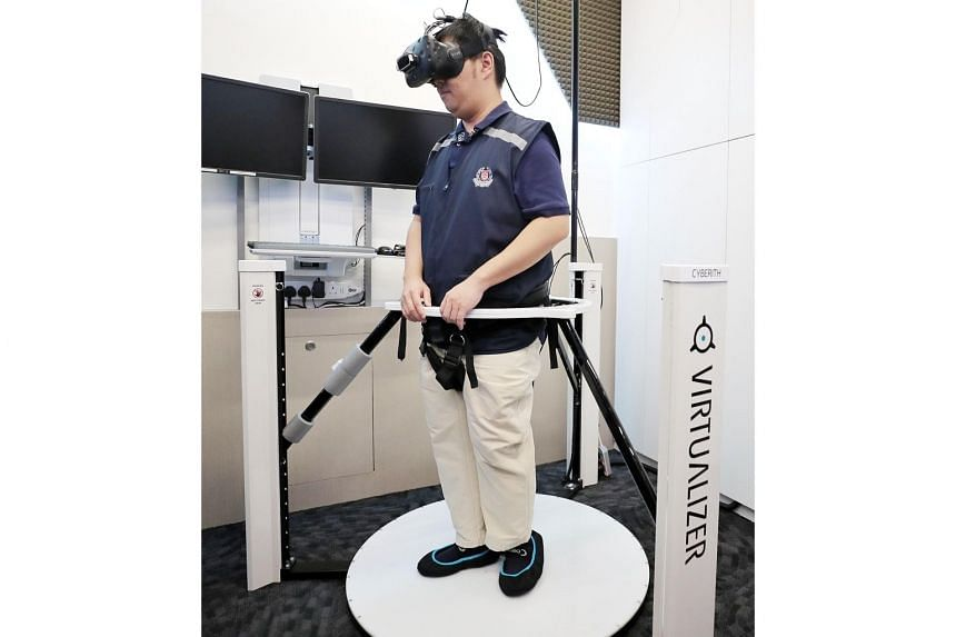 Senior Crime Scene Specialist Wong Jun Yan wearing a VR headset linked to a multi-directional treadmill that allows him to walk around a virtual crime scene and interact with it.