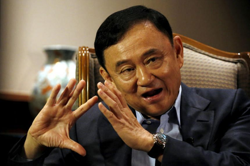 Former Thai Prime Minister Thaksin Shinawatra speaks during an interview in Singapore on Feb 23, 2016.