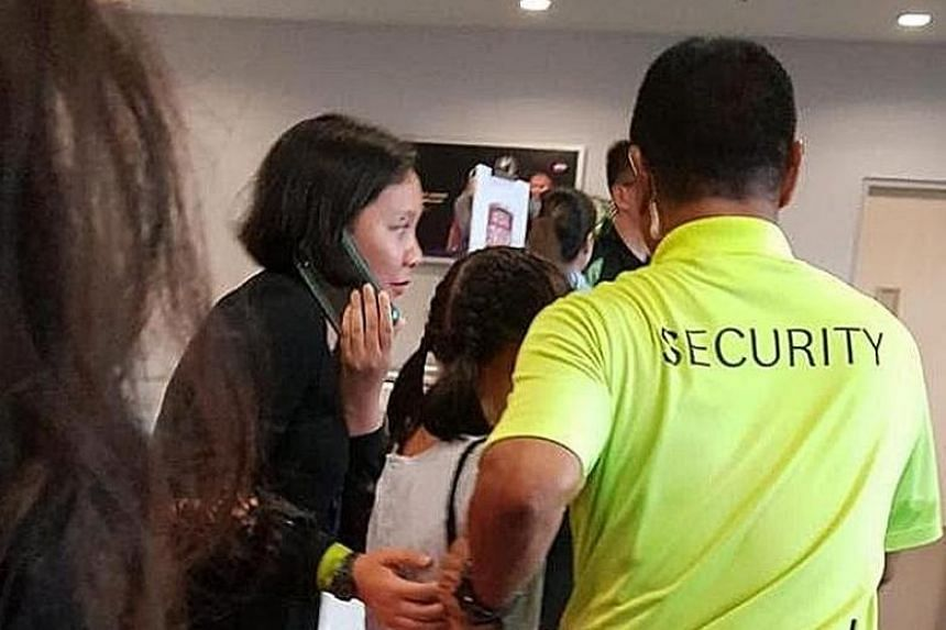 A young BTS fan in tears as she's escorted away after finding out that her ticket was a fake. PHOTO: TNP READER