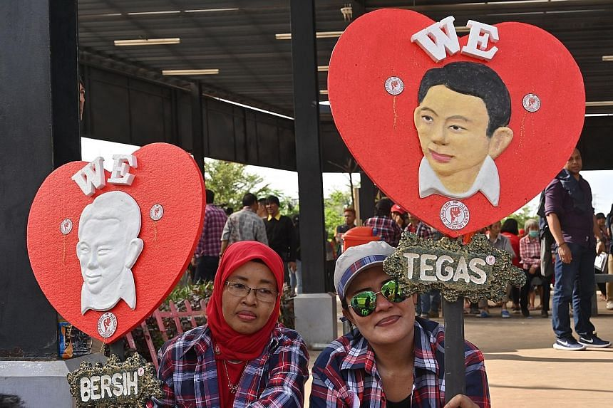 Supporters of former Jakarta governor Basuki Tjahaja Purnama celebrating his release from prison last Thursday. Mr Basuki is being accused of making the Muslim woman he plans to marry commit apostasy.