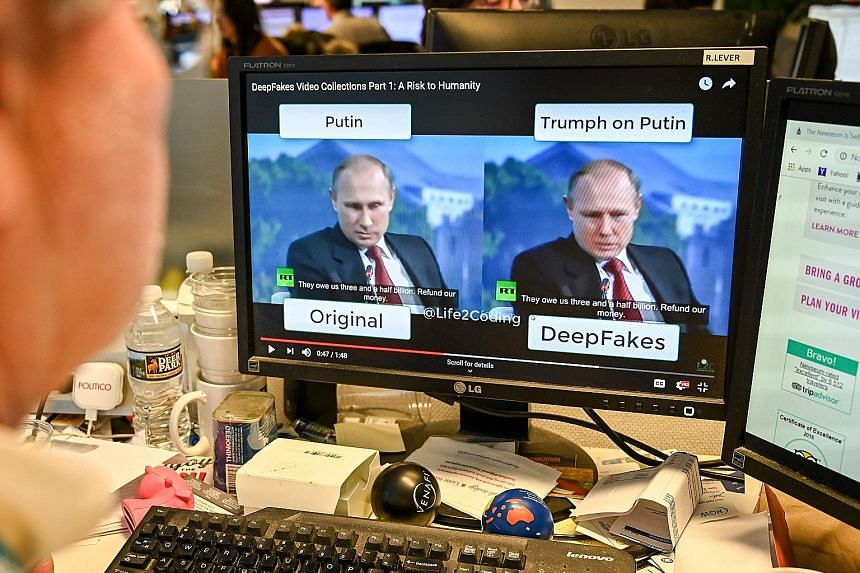 "A journalist viewing a ""deepfake"" video. Such videos are becoming more realistic due to advances in artificial intelligence."