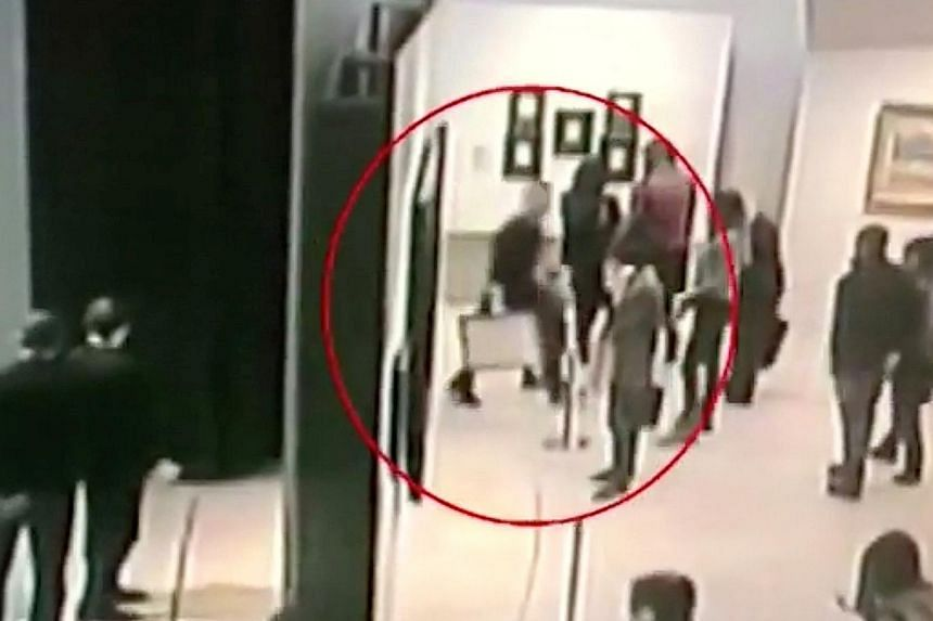 Above: Screen grabs from video footage show a man walking away with a painting at Tretyakov Gallery in Moscow on Sunday. Left: The Arkhip Kuindzhi painting was recovered yesterday undamaged.