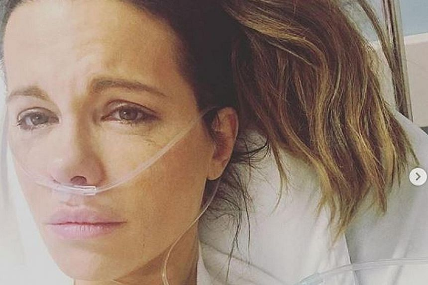 BECKINSALE WARDED FOR RUPTURED OVARIAN CYST: Is actress Kate Beckinsale trying to profit from her ill health? That suspicion was aired by some netizens when the 45-year-old posted photographs and accounts of her medical condition. 	But she has hit ba