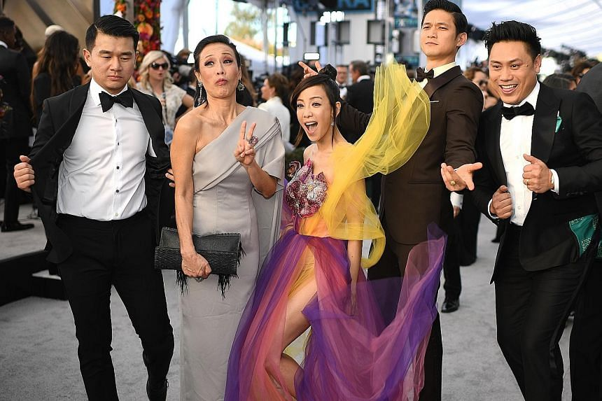 Looking like a million dollars on the red carpet are the cast of Crazy Rich Asians, comprising (above from left) actors Ronny Chieng, Tan Kheng Hua, Fiona Xie and Harry Shum Jr and director Jon M. Chu.