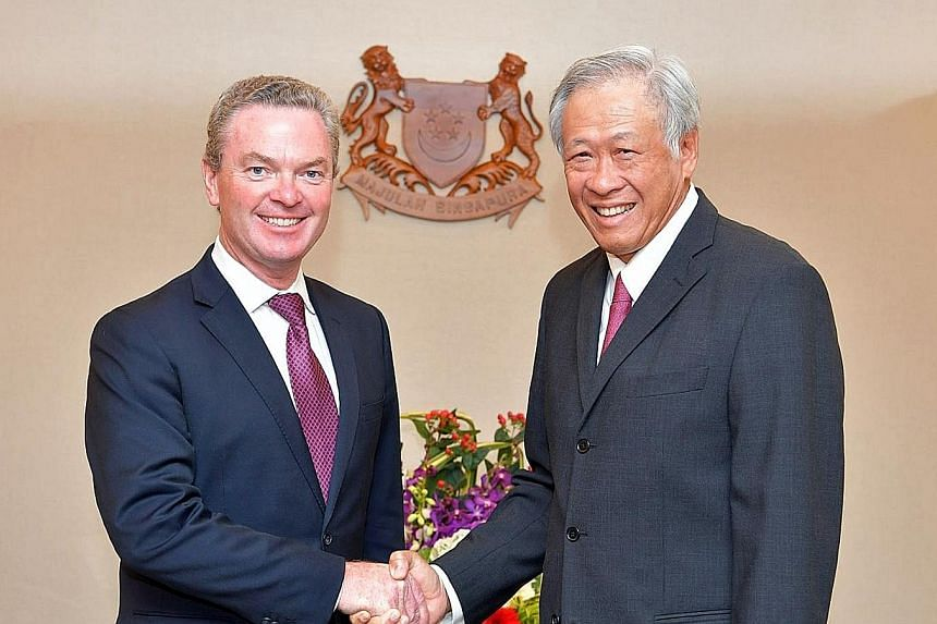 Australian Defence Minister Christopher Pyne, the keynote speaker at the 7th International Institute for Strategic Studies Fullerton Forum: Shangri-La Dialogue Sherpa Meeting, with his Singapore counterpart, Dr Ng Eng Hen, yesterday.