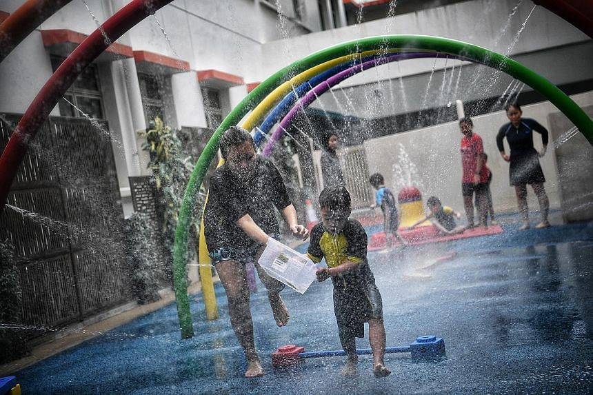 Children enjoying an activity in the Wet Play Area at the Awwa Early Intervention Centre yesterday. When the subsidies are revised, early intervention fees will range from $5 to $430 per month, down from $5 to $780 per month currently.