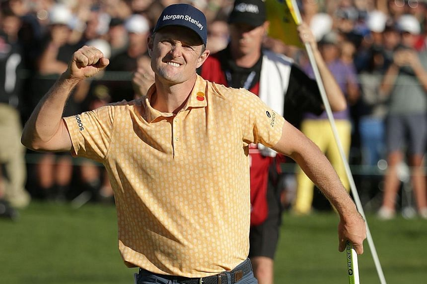 England's Justin Rose celebrating his winning putt at Torrey Pines to clinch a two-shot win over Australian Adam Scott at the Farmers Insurance Open on Sunday. The 38-year-old finished with a total of 21-under 267, a tournament record since the South