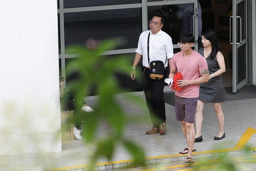 Mr Pang's eldest brother, Mr Jefferson Pang (in pink), leaving Mandai Crematorium yesterday with the late actor's ashes.