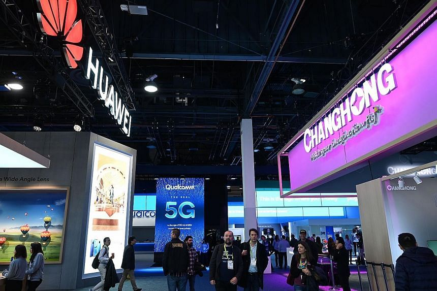 The booths of Chinese firms Huawei and Changhong at this year's CES, the world's largest consumer electronics trade fair, in Las Vegas. Industry experts said Huawei and China are likely to lead the world in 5G technology because of massive investment