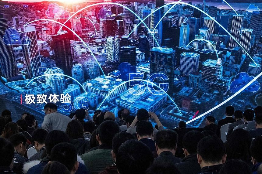Journalists and guests watching a trailer at the launch of Huawei's new 5G products in Beijing last Thursday. Besides China, countries that are trialling or beginning to roll out national 5G networks this year include South Korea, the United States a