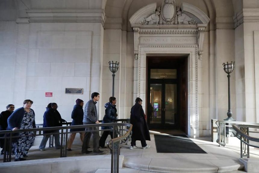 Federal employees return to work at the Environmental Protection Agency headquarters in Washington, DC, on Jan 28, 2019.