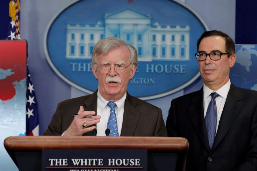 White House National Security Adviser John Bolton (left) and Treasury Secretary Steven Mnuchin announce economic sanctions against Venezuela and oil company Petroleos de Venezuela at the White House in Washington, US, on Jan 28, 2019.