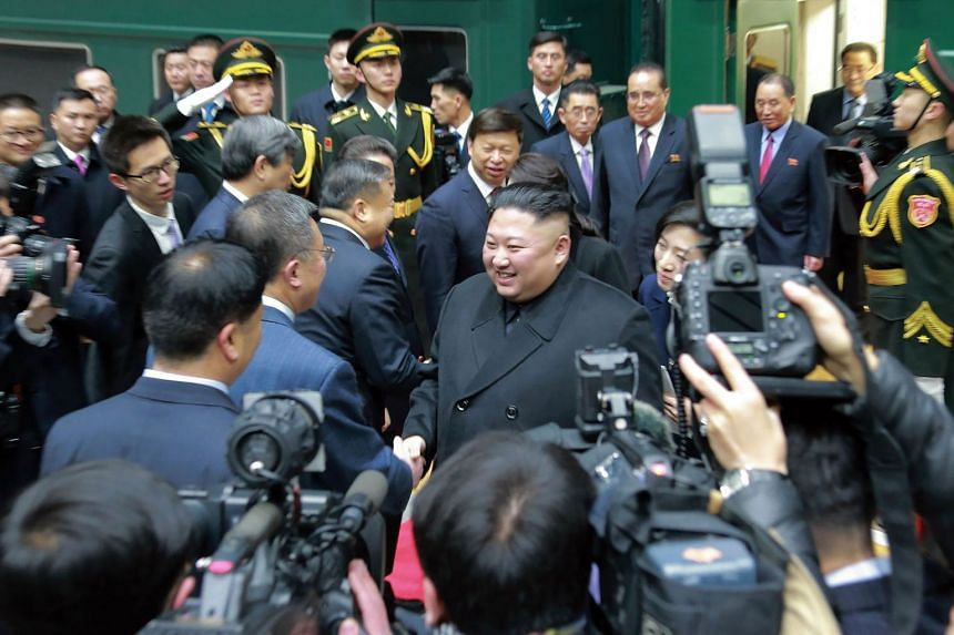 North Korean leader Kim Jong-Un (centre) being welcomed by Chinese officials upon his arrival at Dandong station, China's border city, in Jan 7, 2019.