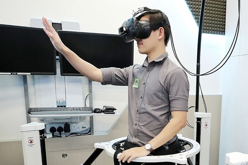 Above: The virtual reality (VR) platform allows trainees to hone their decision-making skills in a realistic but safe learning environment. Left: ST reporter Fabian Koh trying out the VR set-up, which allows the user to interact with a virtual crime
