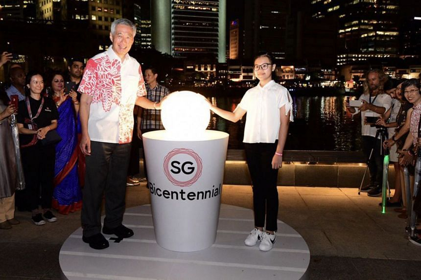 Prime Minister Lee Hsien Loong with Kayla Choy, 11, the youngest participant in the bicentennial launch. She and others will document the history of her school, St Anthony's Canossian.