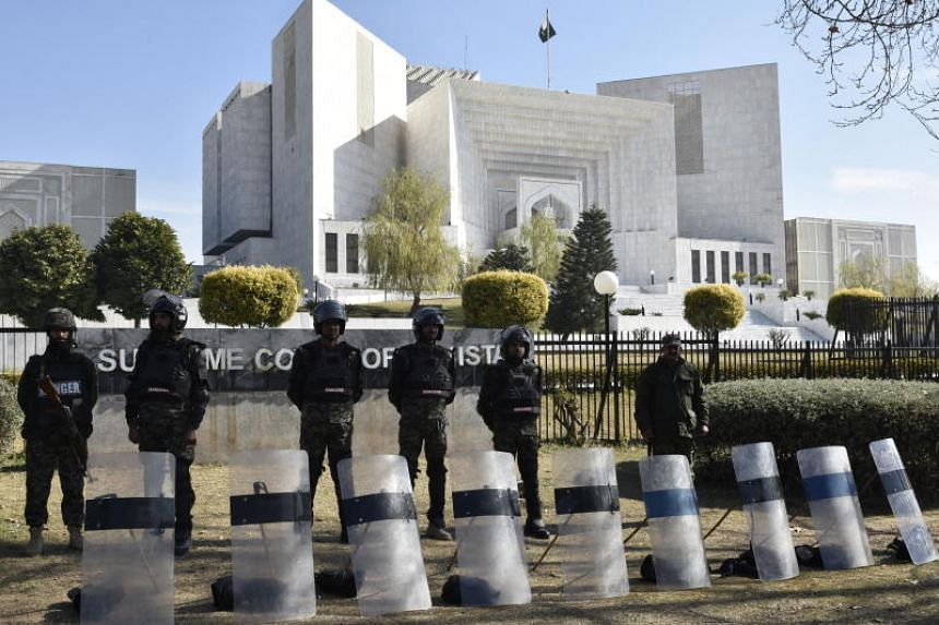 Pakistani security officials stand guard outside the Supreme Court as the court hears an appeal against the acquittal for Asia Bibi on Jan 29, 2019.