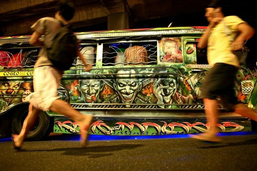 A jeepney with custom artwork on its side during rush hour in Manila on Jan 14, 2019.
