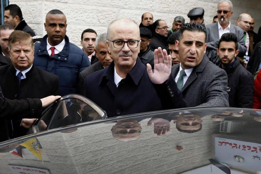 Palestinian Prime Minister Rami Hamdallah waves as he attends an event in the West Bank village of Beit Ula, near Hebron, on Jan 28, 2019.