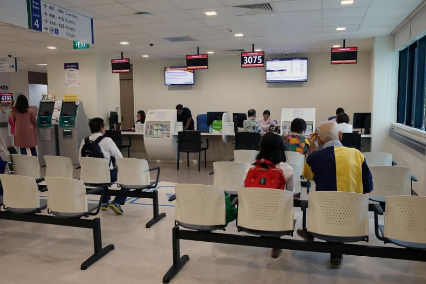 File photo showing people at a waiting room of a medical facility at Singapore General Hospital, on Feb 20, 2017.