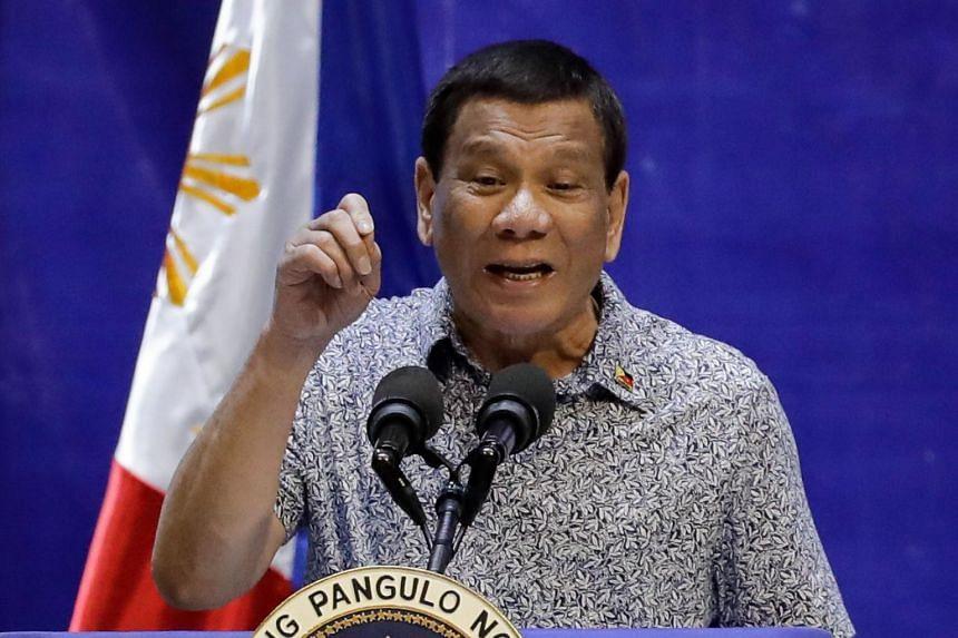 Philippine President Rodrigo Duterte gestures as he speaks during a summit in Manila on Jan 23, 2019.