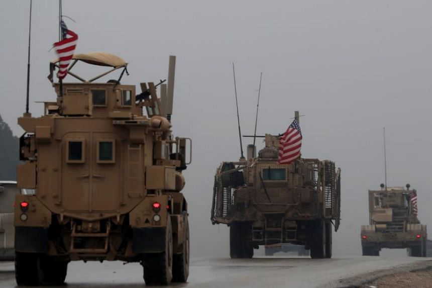 A line of US military vehicles in Syria's northern city of Manbij on Dec 30, 2019.