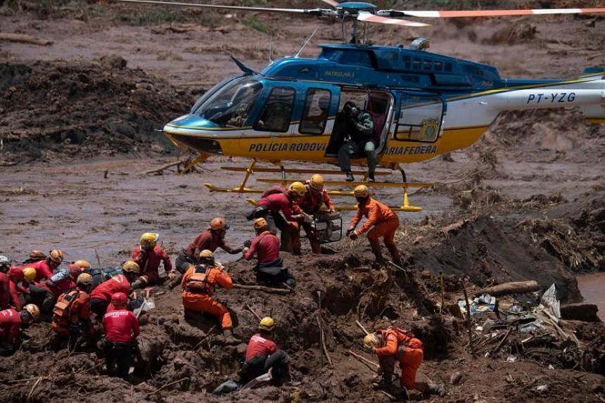 Firefighters searching for victims of Friday's dam collapse near the town of Brumadinho, southeastern Brazil, on Jan 28, 2019.