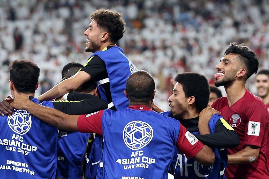 Qatar players celebrate the 3-0 goal against UAE.