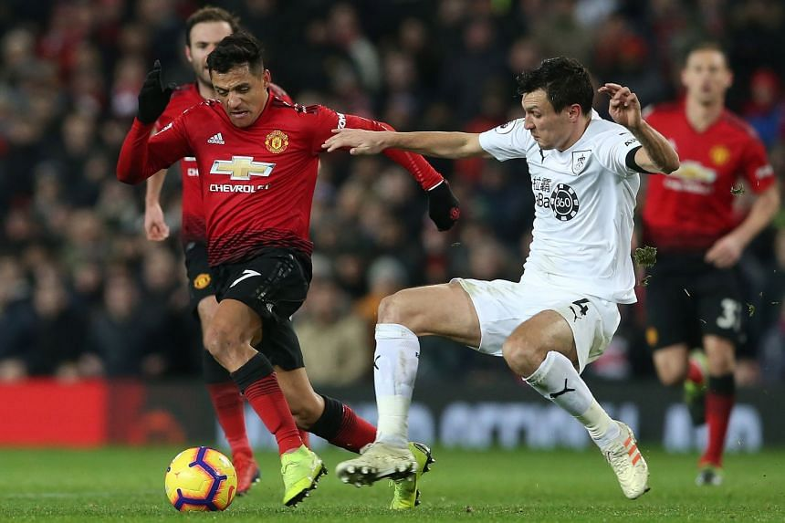 Manchester United's Alexis Sanchez (L) in action with Burnley's Jack Cork.