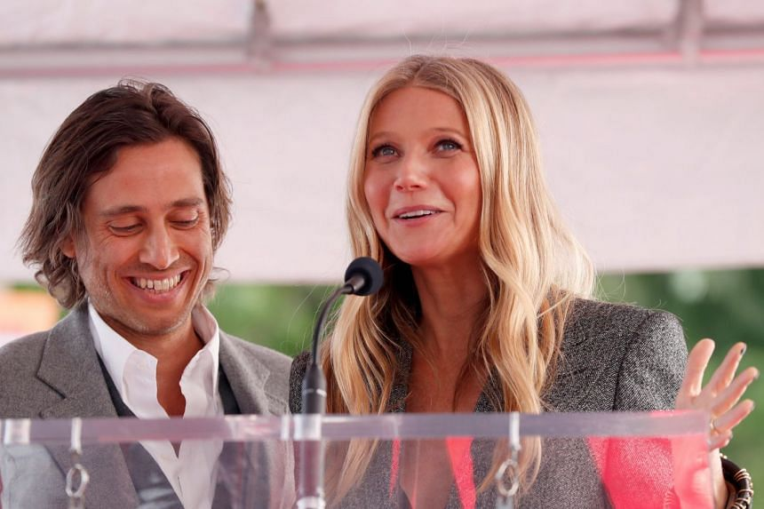Paltrow and husband Brad Falchuk speak prior to the unveiling of director Ryan Murphy's star on the Hollywood Walk of Fame.