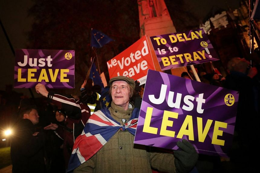 Pro-Brexit demonstrators protest outside the Houses of Parliament, in Westminster, London.