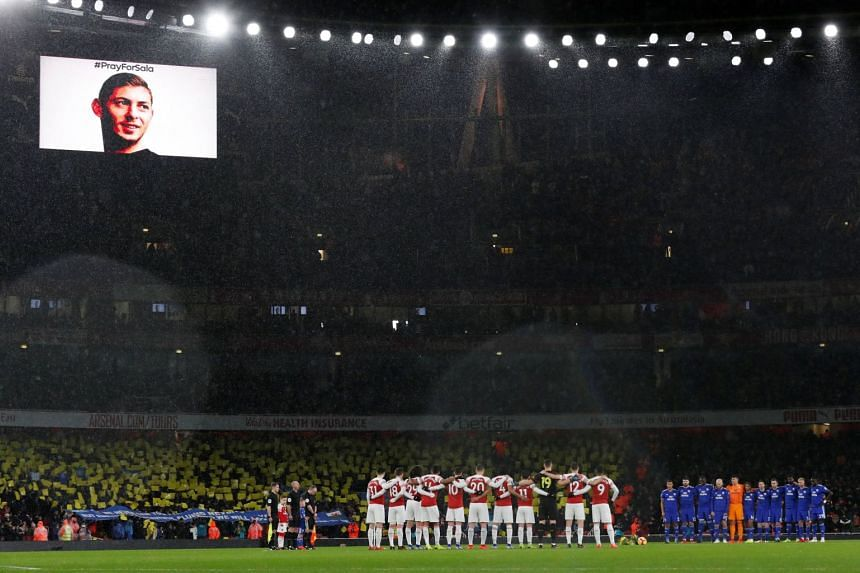 Arsenal and Cardiff players and fans hold a minute's silence as a tribute to Emiliano Sala before the match.
