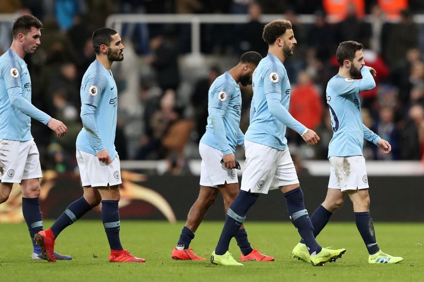 Manchester City players look dejected after the match.