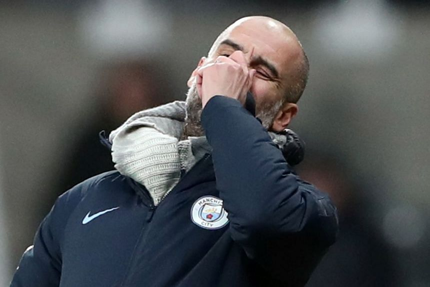 Manchester City manager Pep Guardiola reacts during the match.