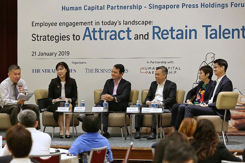 (From left) Straits Times senior executive sub-editor Toh Yong Chuan moderating the Human Capital Partnership-Singapore Press Holdings Forum on employee engagement with panellists, Ms Rebecca Chew, deputy managing partner of Rajah & Tann; Mr Zaqy Moh