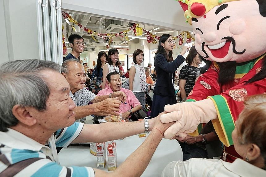 More than 60 senior citizens and 20 volunteers attended the event organised by SPH's Staff Volunteers Club. Software engineer Archimedes Rodil, who dressed up as the God of Fortune, said he could see the joy and hope in the eyes of the seniors as he