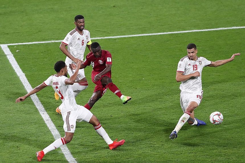 Almoez Ali curling the ball into the bottom corner for Qatar's second goal in their Asian Cup semi-final against the United Arab Emirates at the Mohammed bin Zayed Stadium in Abu Dhabi last night. They won 4-0 and have yet to concede in six games.