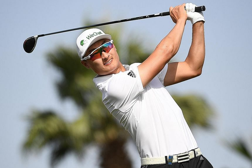 Chinese golfer Li Haotong in the final round of the Dubai Desert Classic. He was penalised two shots at the last hole as his caddie moved to the side after he took his stance for a putt.