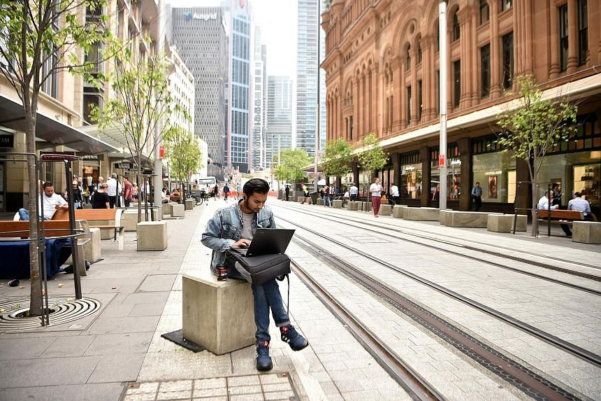 The central business district of Sydney. Australia's business conditions index - measuring hiring, sales and profits - slipped to two last month from 11 a month earlier, a National Australia Bank report showed yesterday. The result dovetails with slo
