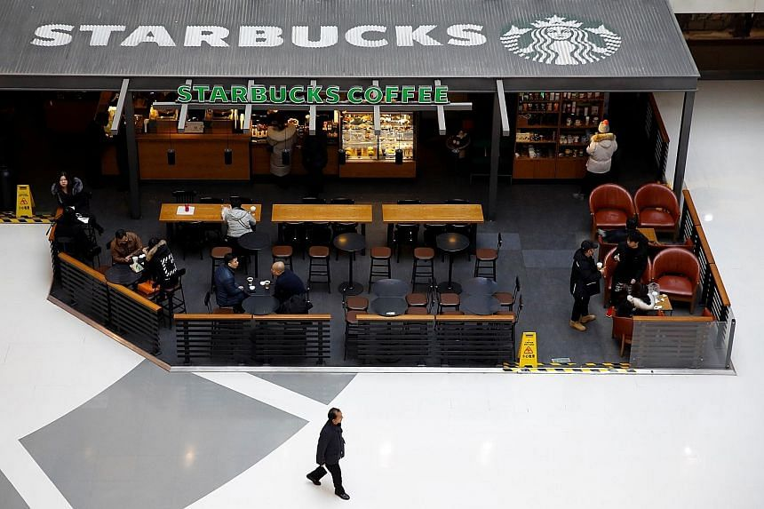 Starbucks is opening a new store every 15 hours in China, in a sign that retail remains a bright spot in the country. Caterpillar posted its biggest quarterly profit shortfall in a decade. Intel cited softness in China among the reasons for its lower
