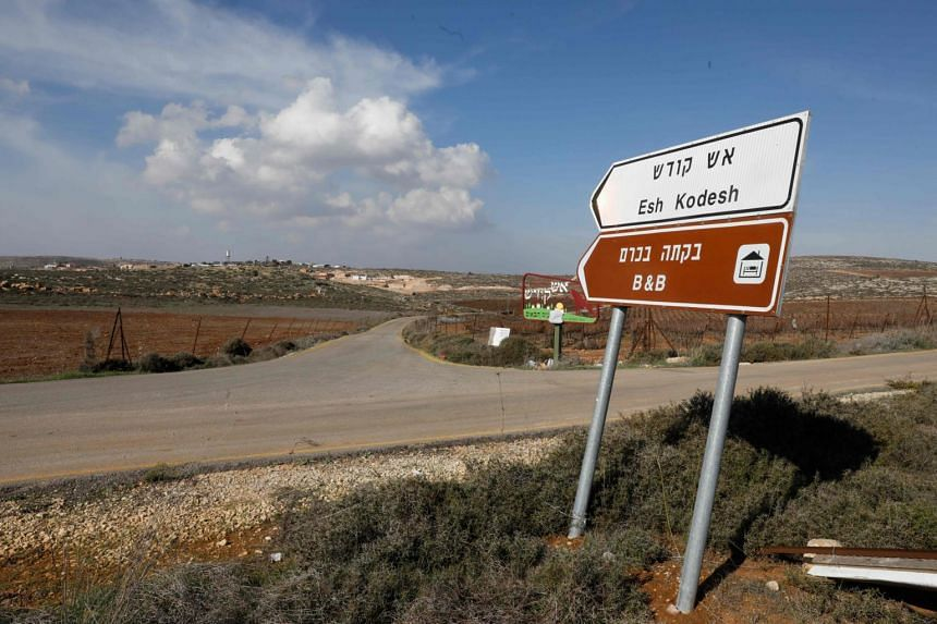 A road sign points towards an Airbnb apartment, located in the Esh Kodesh outpost, near the Jewish settlement of Shilo and the Palestinian village of Qusra in the occupied West Bank on Nov 20, 2018.