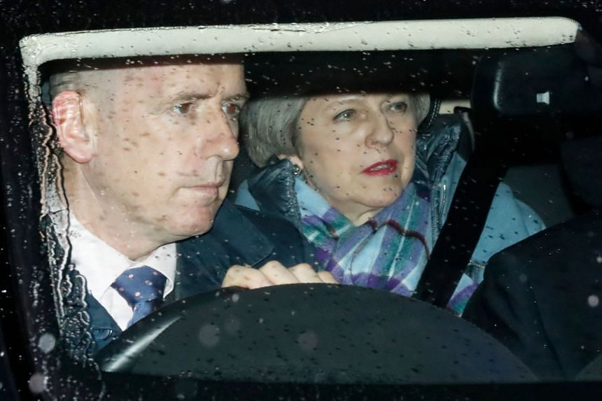 Britain's Prime Minister Theresa May leaves parliament after MP's voted to change her Brexit deal.