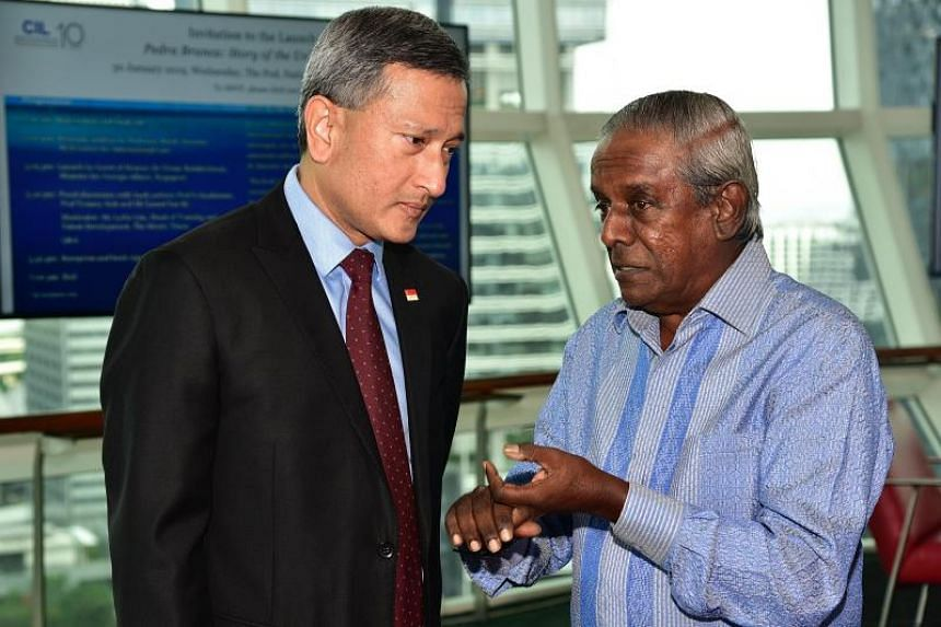 Minister for Foreign Affairs Vivian Balakrishnan (left) speaking with former senior minister S. Jayakumar at the dialogue session for the book launch of Pedra Branca: Story Of The Unheard Cases.
