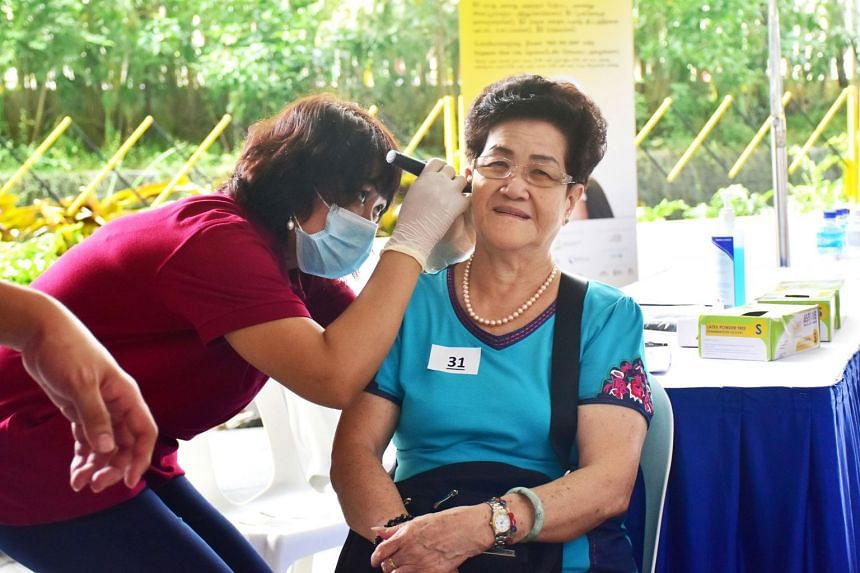 Senior citizens aged 60 and above can get their ears checked at the Project Silver Screen functional screening programme. PHOTO: MINISTRY OF HEALTH