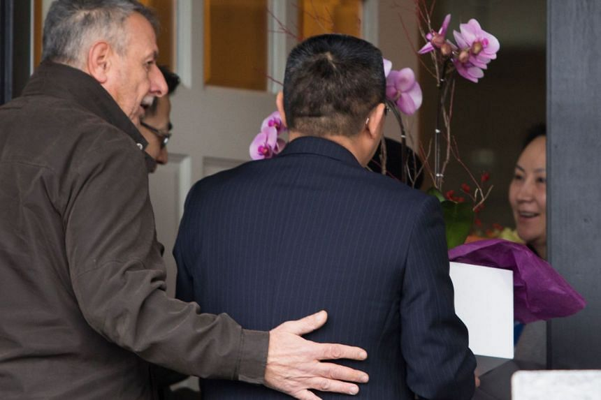 Visitors bringing flowers to the home of Meng Wanzhou (far right) after she was released on bail.