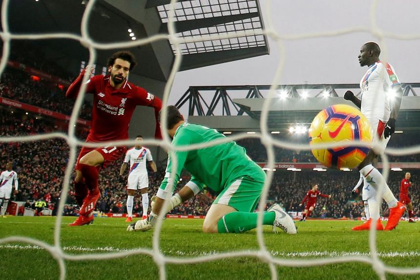 Liverpool's Mohamed Salah celebrates scoring their first goal as Crystal Palace's Julian Speroni looks dejected during a Premier League match on Jan 19, 2019.
