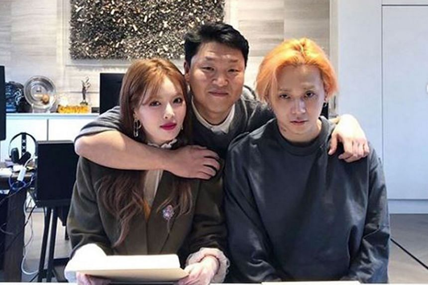 K-pop artists HyunA and E'Dawn with South Korean singer Psy (centre).