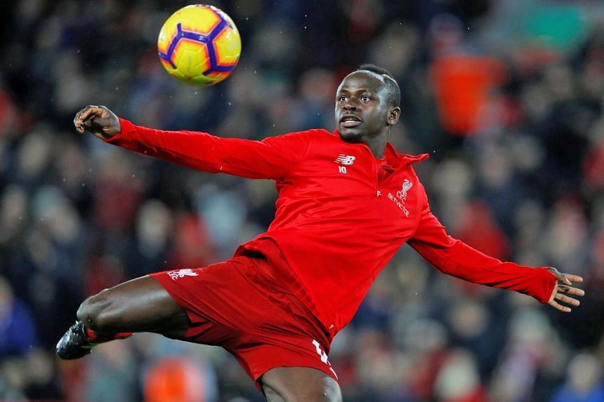 Liverpool's Senegal international Sadio Mane says his strike partners Mohamed Salah and Roberto Firmino are the reasons behind his decision to extend his contract to 2023.