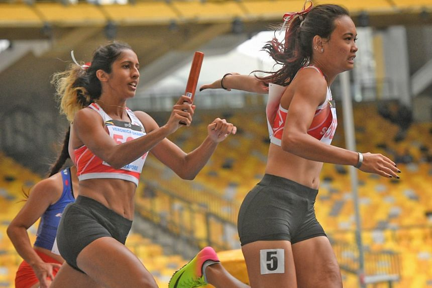 Shanti Pereira passing the baton to anchor runner Nur Izlyn Zaini in the 2017 SEA Games 4x100m final, where they set a Singapore record of 44.96 seconds with Wendy Enn and Dipna Lim Prasad.