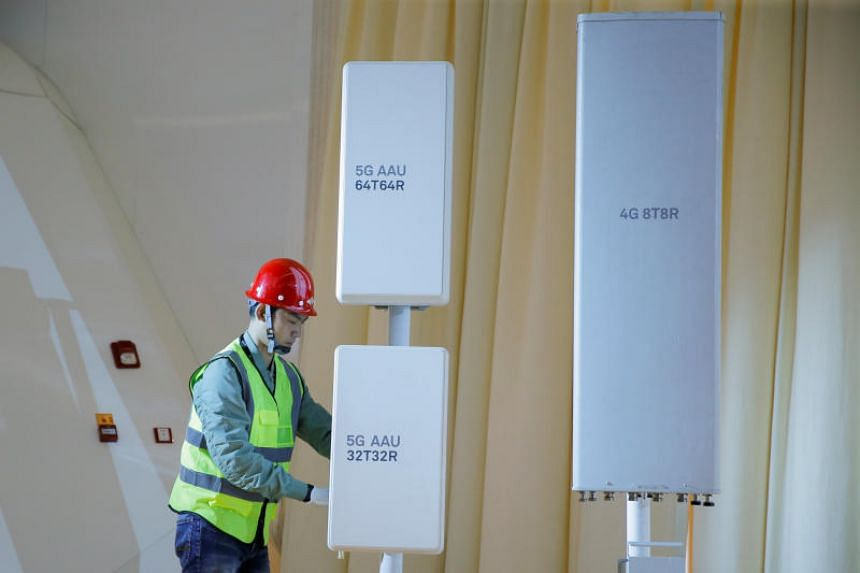 A staff member displays 5G active antenna units during a product presentation in Beijing, China, on Jan 24, 2019.