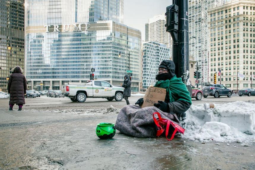 A homeless man sits at Upper Wacker Drive in Chicago on Jan 29, 2019.
